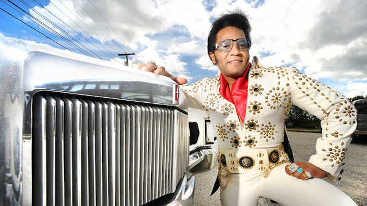 When Elvis impersonator Robert Washington of Auburn saw an article in the newspaper about the 1970 Lincoln Mark III being raffled off by the YWCA in Lewiston he thought about putting in a bid. He did not get a chance to do it, but after seeing a documentary of Elvis Presley driving the same vehicle onto the MGM studio in Hollywood, he headed down to see if it was not too late to put in a bid. He made it in time and was the highest bidder. The first thing he wants to do is get it out of the sun and under cover to preserve the paint and vinyl roof. He hopes to drive it to some of his local shows he does in the future. The YWCA will put the money toward the Gendron Challenge that has surpassed the $100,000 figure that will be used to upgrade infrastructure and install new energy saving equipment.